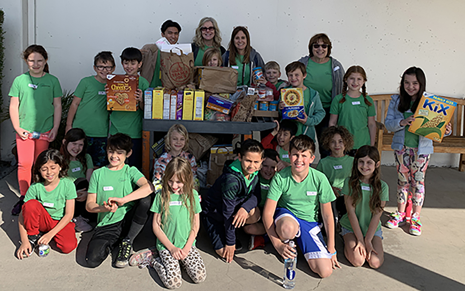 Photo: 2nd Graders Posing with Food Drive Items