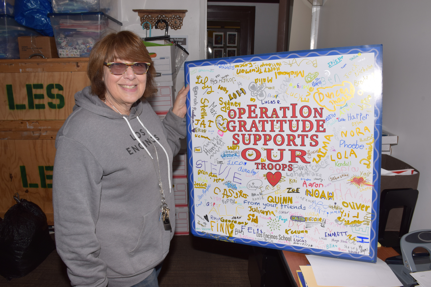 Photo: The author with an Operation Gratitude poster