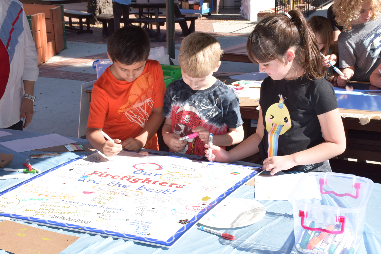 Photo: Kids decorating gratitude posters.
