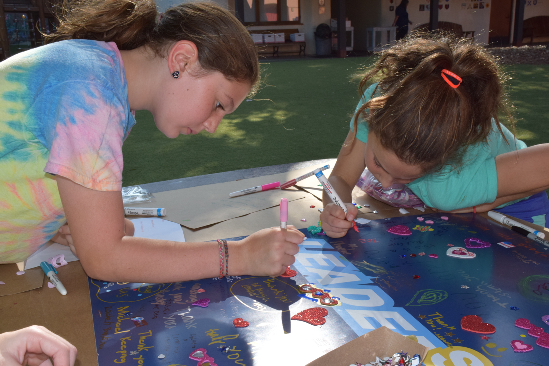 Photo: Kids decorating posters of gratitude.