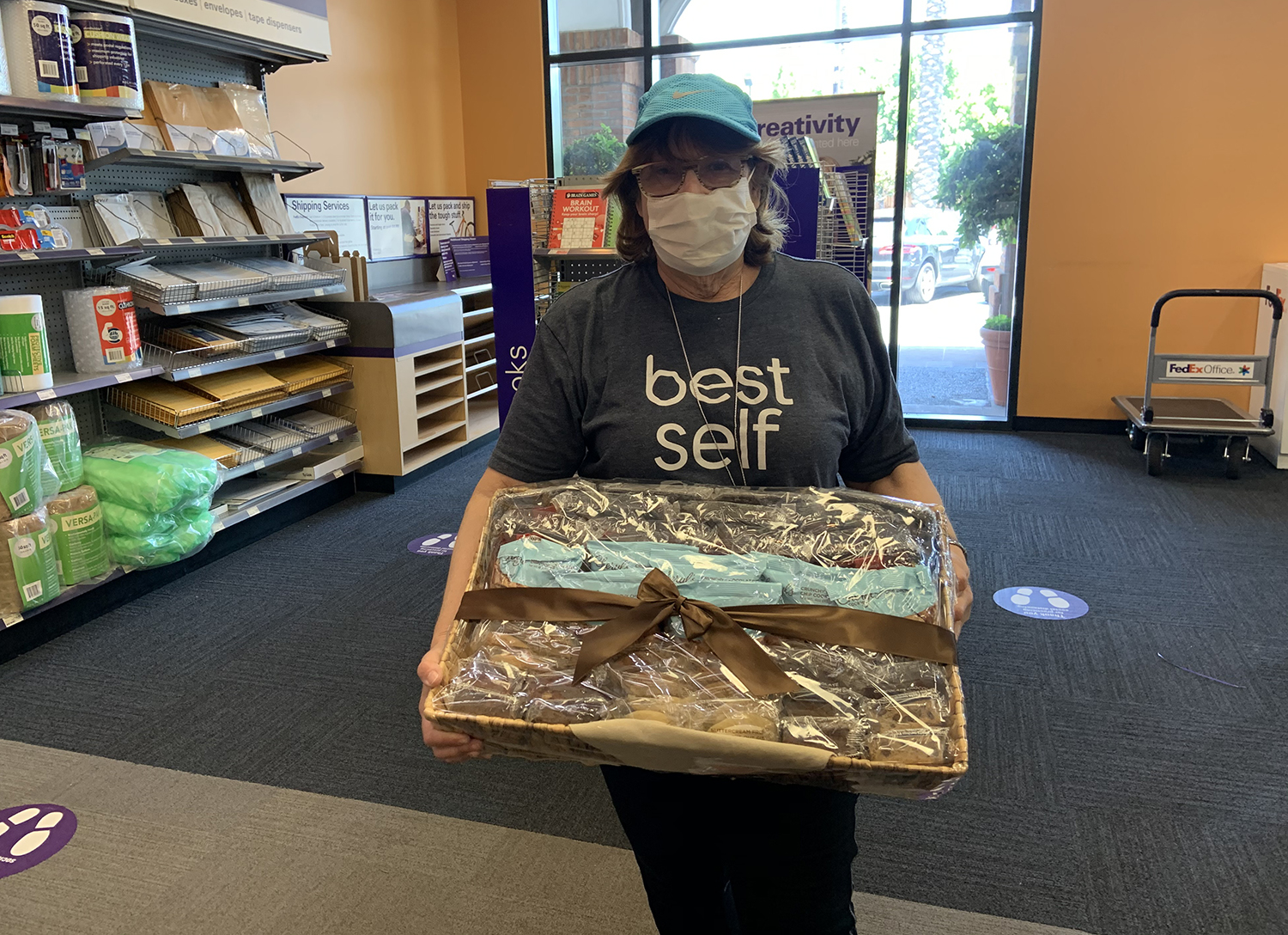 Photo: Jenny delivers baked goods to frontline workers at Fed-Ex.
