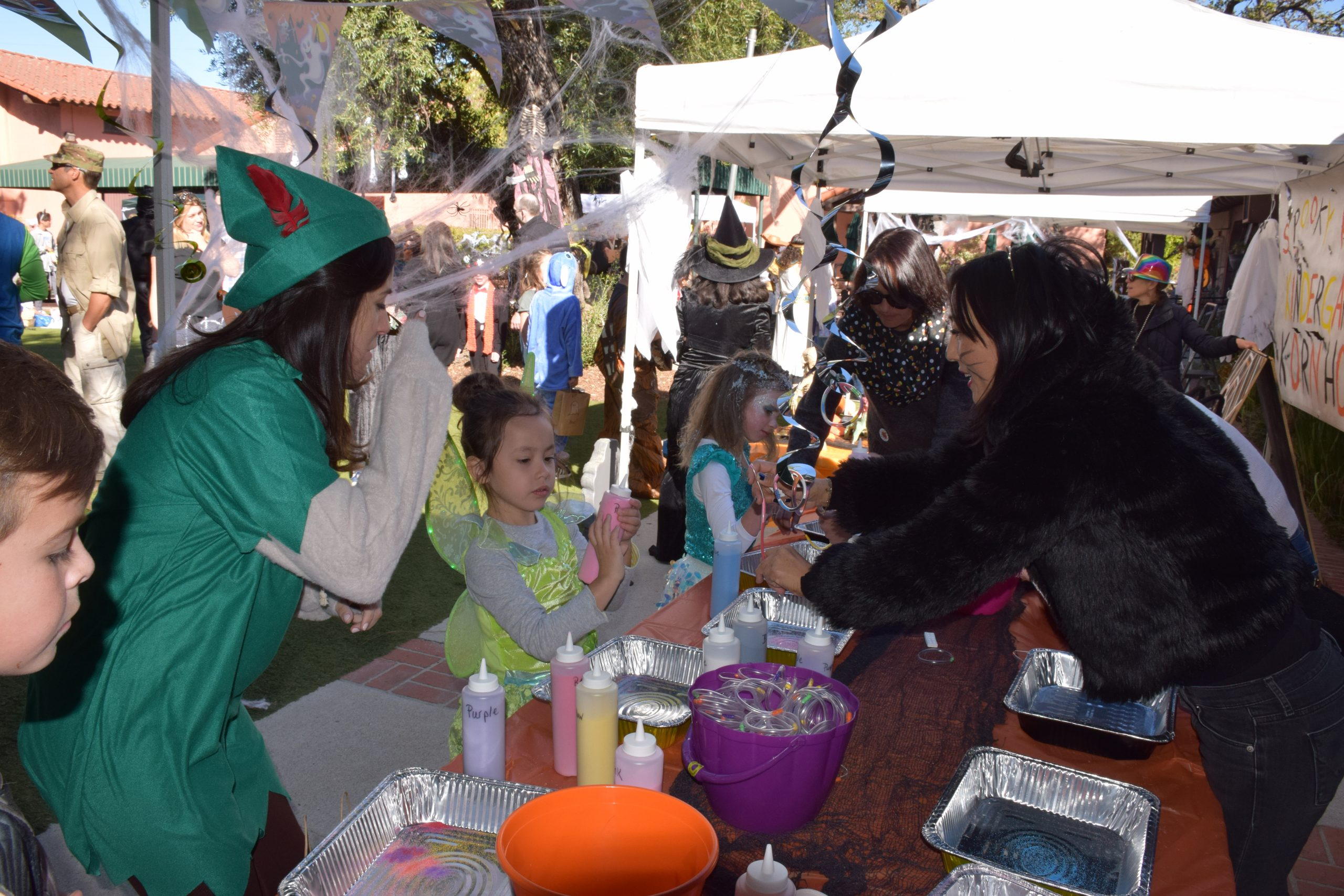 Photo: Parents volunteer at the Halloween Festival.