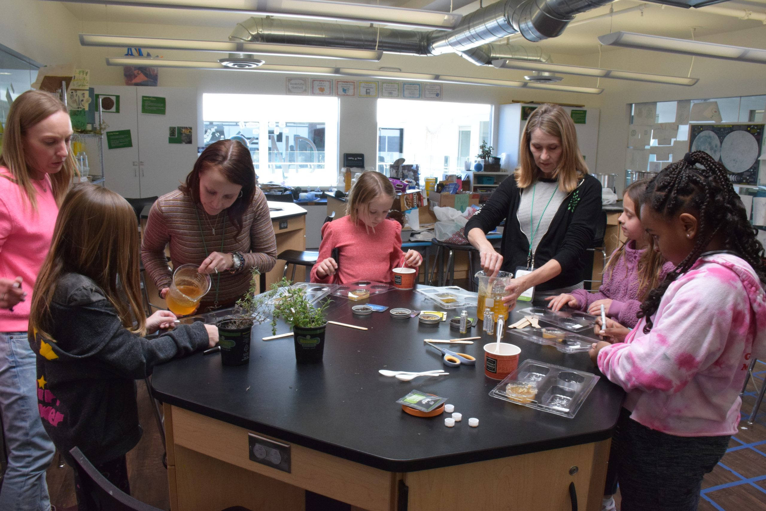Photo: Parents volunteer to help with 4th grade's colonial concoctions.