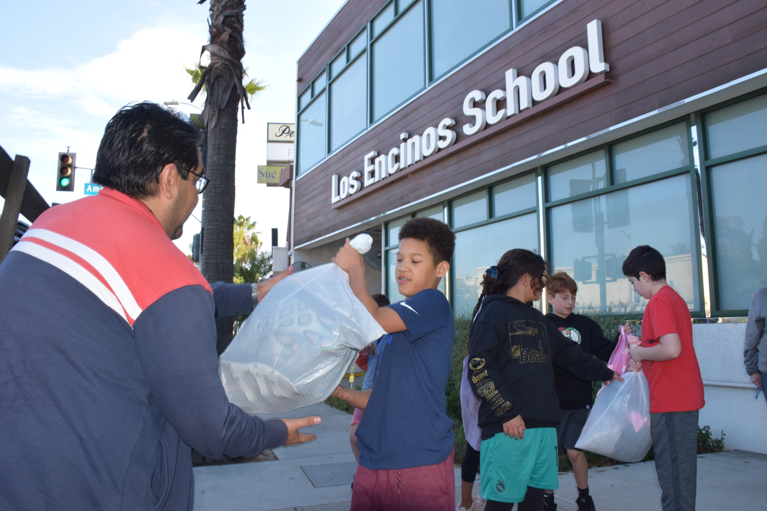 5th graders load the MEND truck with donations of gently-used clothing.